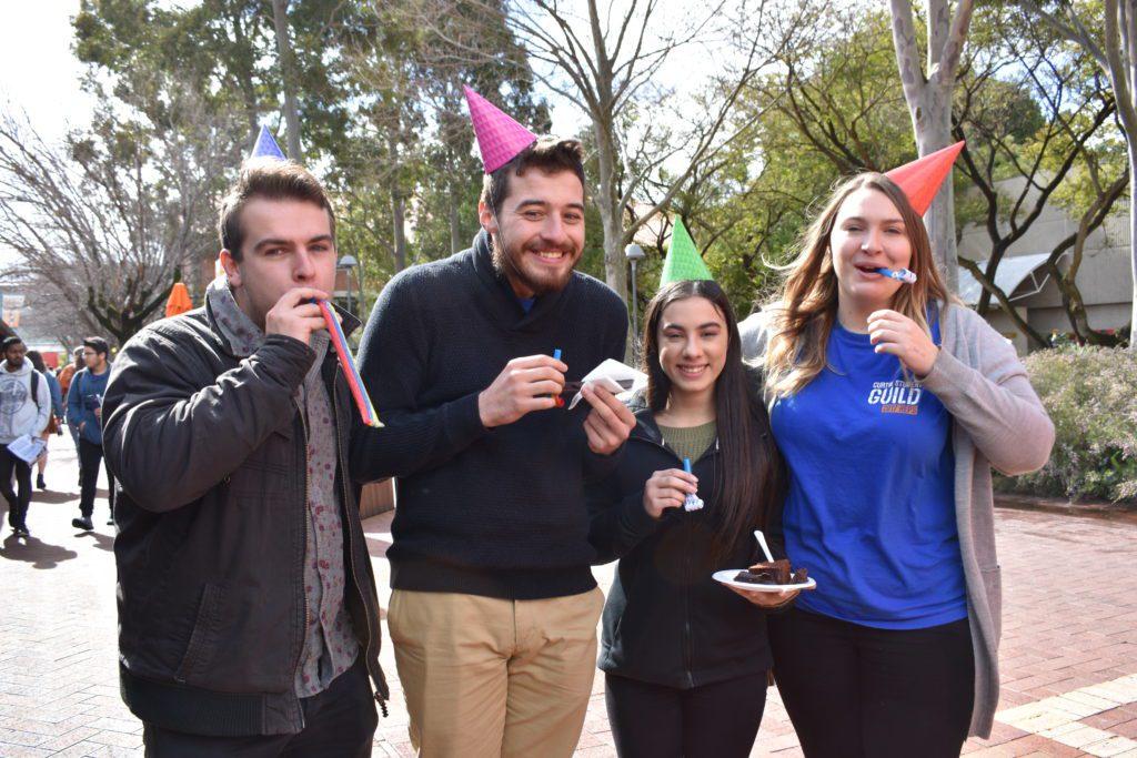 Students enjoy 50th anniversary cake